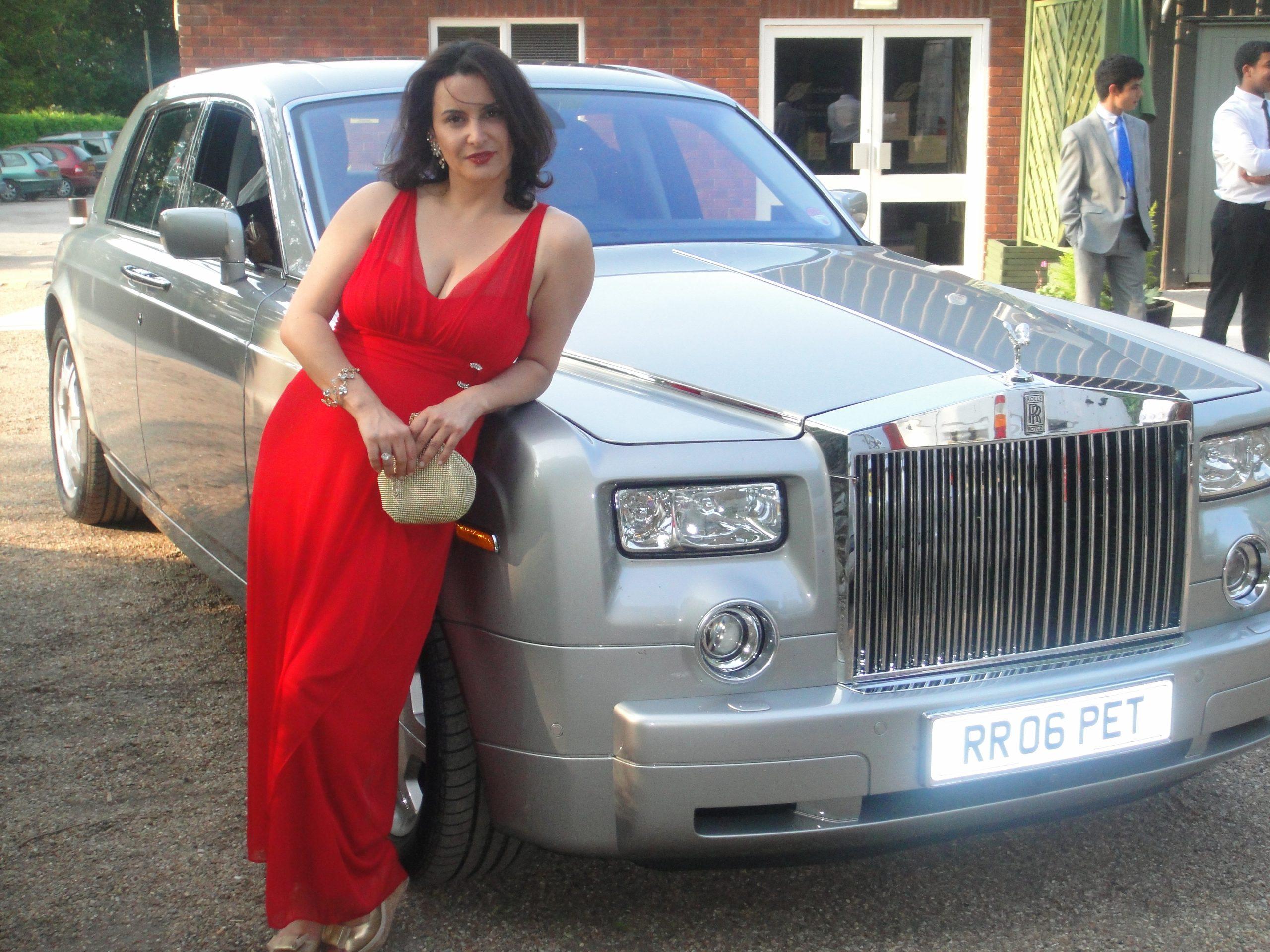 Genealogist Poses with Phantom Rolls Royce